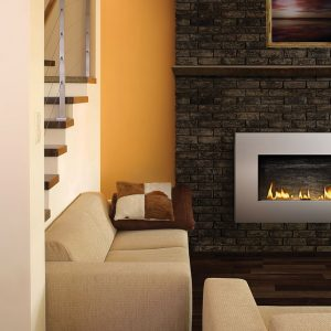 ptopane fireplace on brick wall near beige couches and stairwell