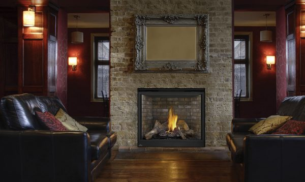 living room with black leather couches and propane fireplace