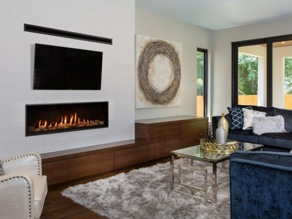 living room with couch, coffee table, and propane fireplace